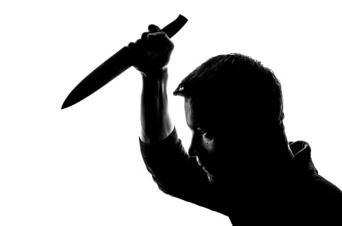 Silhouette with knife